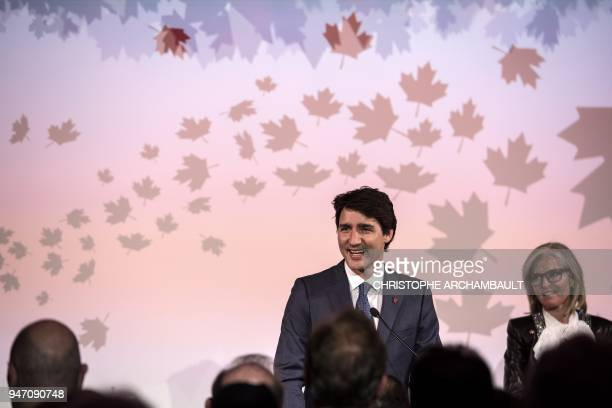 Canadian Prime Minister Justin Trudeau delivers a speech flanked by Canadian Ambassador to France Isabelle Hudon during the inauguration of the new...
