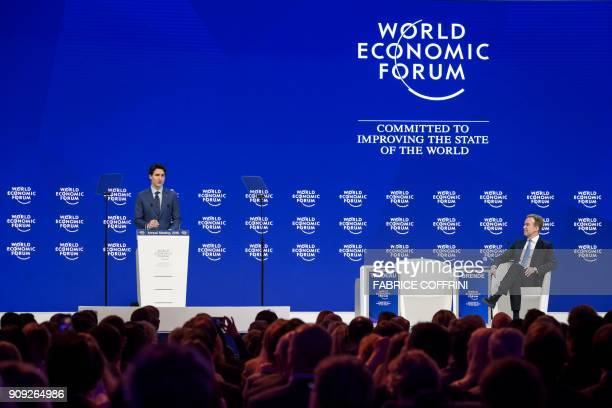 Canadian Prime Minister Justin Trudeau delivers a speech next to World Economic Forum President Borge Brende during the annual World Economic Forum...