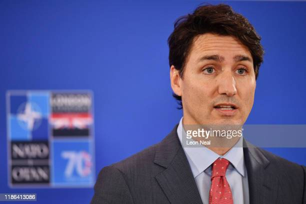 Canadian Prime Minister Justin Trudeau gives a press conference in the media centre at the NATO summit held in the Grove hotel in on December 4, 2019...