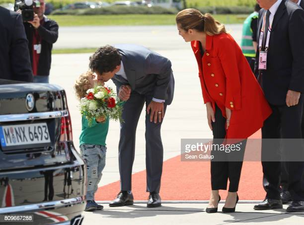 Canadian Prime Minister Justin Trudeau gives his son Hadrien a kiss before stepping into a different car as Trudeau's wife Sophie Gregoire alooks on...