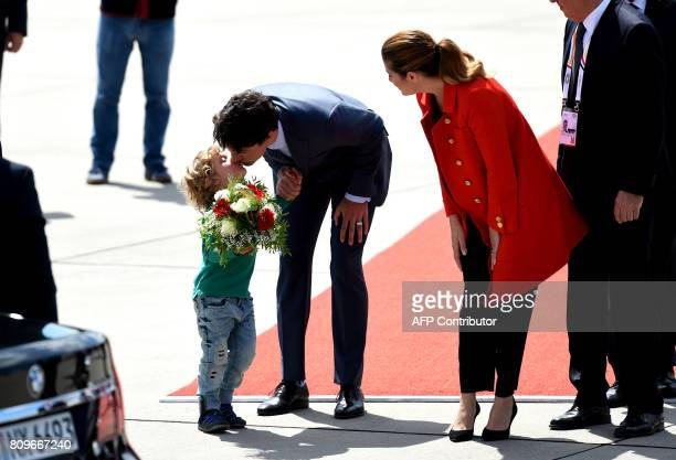 Canadian Prime Minister Justin Trudeau his wife Sophie Gregoire and his son Hadrian arrive at the airport in Hamburg northern Germany on July 6 2017...
