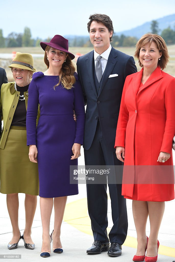 Canadian Prime Minister Justin Trudeau (C), his wife Sophie Gregorire (L) and Christy Clark (R) at Victoria Airport to greet the British Royal Family on September 24, 2016 in Victoria, Canada.