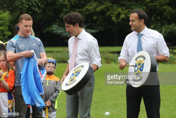 Canadian Prime Minister Justin Trudeau is presented with an Irish football shirt by Dublin GAA footballer Ciaran Kilkenny after receiving a Bodhran...