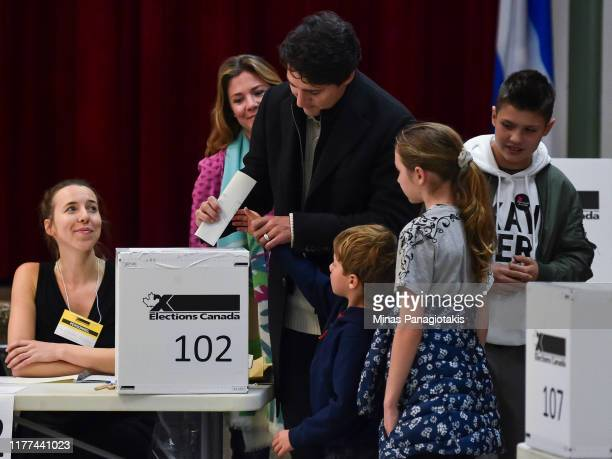 Canadian Prime Minister Justin Trudeau is surrounded by his family as he casts his vote on election day at a polling station on October 21, 2019 in...
