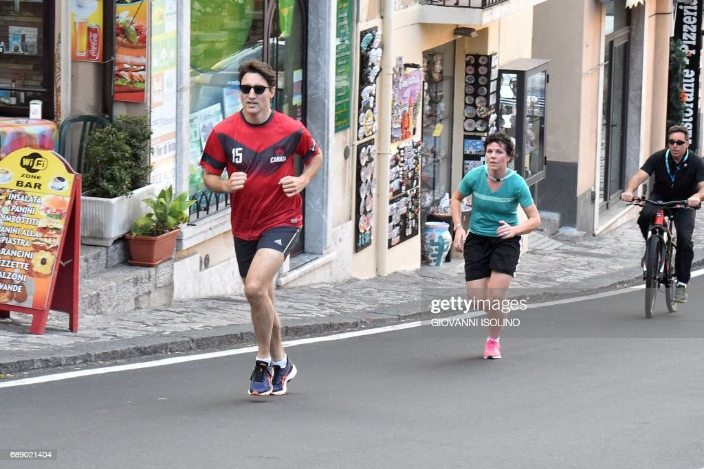 Canadian Prime Minister Justin Trudeau jogs in Taormina after a G7 Summit of Heads of State and of Government, on May 27, 2017 in Sicily. /