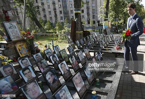 Canadian Prime Minister Justin Trudeau lays flowers at the monument to the Heavenly Hundred in memory of the activists who died during the Maidan...