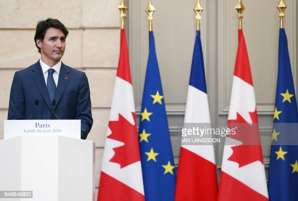 Canadian Prime Minister Justin Trudeau looks on as he holds a joint press conference with the French President at the Elysee Palace in Paris on April...