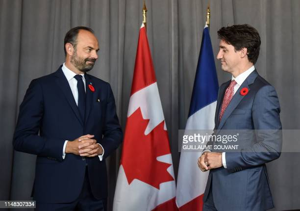 Canadian Prime Minister Justin Trudeau meets with French Prime Minister Edouard Philippe during a bilateral on the sideline of the international...