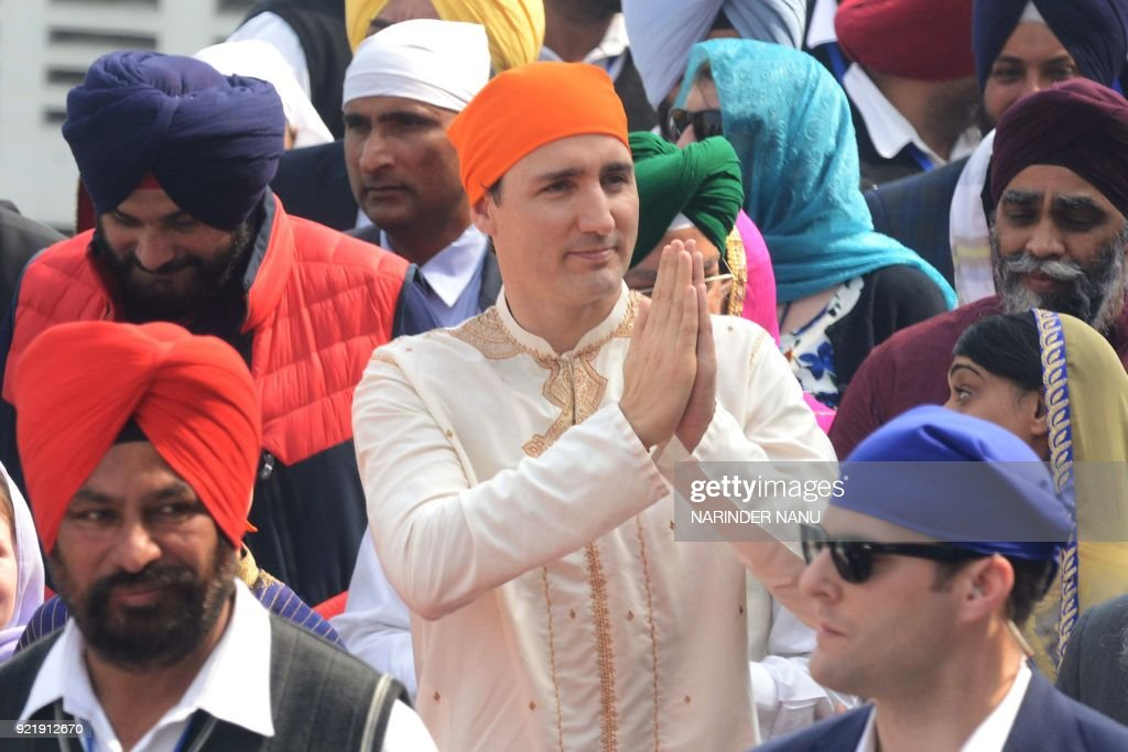 Canadian Prime Minister Justin Trudeau pays his respects at the Sikh Golden Temple in Amritsar on February 21 2018 Trudeau and his family are on a...