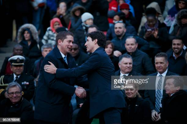 Canadian Prime Minister Justin Trudeau right shakes hands with the leader of the Conservative Party of Canada Andrew Scheer as they attend a vigil...
