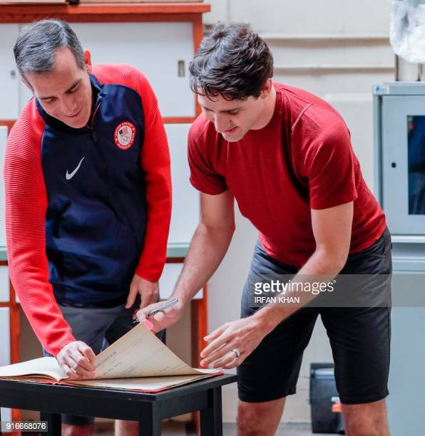 Canadian Prime Minister Justin Trudeau right signs a visitor's book while visiting Griffith Observatory's original 12inch Zeiss refracting telescope...