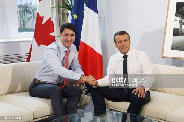 Canadian Prime Minister Justin Trudeau shakes hands with French President Emmanuel Macron during a bilateral meeting in Biarritz southwest France on...