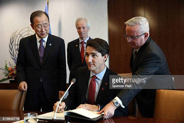 Canadian Prime Minister Justin Trudeau signs a guest book as he meets with United Nations SecretaryGeneral Ban Kimoon at the United Nations...