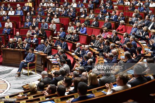 Canadian Prime Minister Justin Trudeau sits in front of members of the French Government and lawmakers prior to delivering a speech at the French...