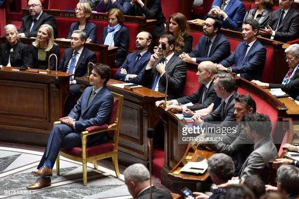 Canadian Prime Minister Justin Trudeau sits in front of members of the French Government prior to delivering a speech at the French National Assembly...