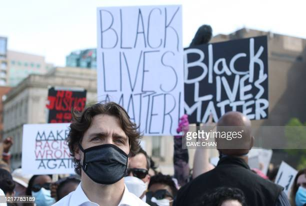 Canadian Prime Minister Justin Trudeau takes part in a Black Lives Matter protest on Parliament Hill June 5, 2020 in Ottawa, Canada. - Canadian Prime...