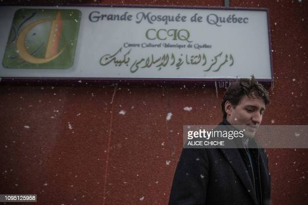 Canadian Prime Minister Justin Trudeau talks to the press after a meeting with the Muslim community at the Islamic Cultural Center of Quebec in...