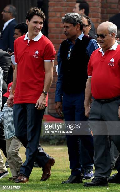 Canadian Prime Minister Justin Trudeau talks with former Indian cricketer Kapil Dev during a cricket event at a school in New Delhi on February 22...