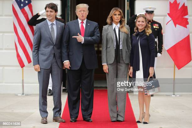 Canadian Prime Minister Justin Trudeau US President Donald Trump first lady Melania Trump and Sophie Gregoire Trudeau pose for photographs at the...