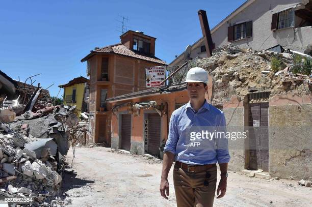 Canadian Prime Minister Justin Trudeau walks during a visit in earthquake-devastated village Amatrice, on May 28, 2017. Amatrice is part of the area...