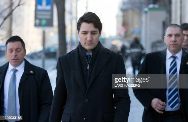 Canadian Prime Minister Justin Trudeau walks to a press conference from the Prime Minister's office in Ottawa Ontario on March 7 2019 Trudeau on...