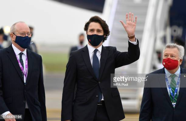 Canadian Prime Minister Justin Trudeau waves as he arrives ahead of the G7 meeting at Cornwall airport on June 10, 2021 in Newquay, England. UK Prime...