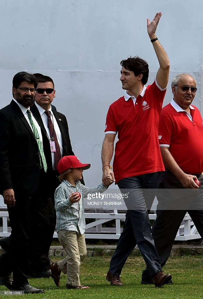 Canadian Prime Minister Justin Trudeau (C) waves as he leaves after a cricket event at a school in New Delhi on February 22, 2018. Trudeau and his family are on a week-long official trip to India. /