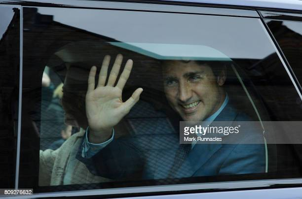 Canadian Prime Minister Justin Trudeau waves to crowds from his Range Rover outside Holyroodhouse after an audience with The Queen at Holyroodhouse...