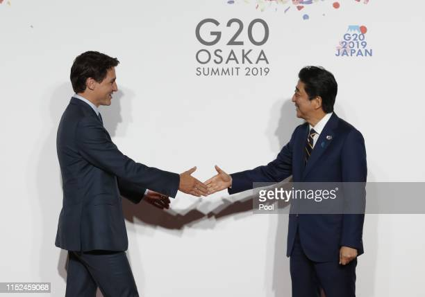 Canadian Prime Minister Justin Trudeau welcomed by Japanese Prime Minister Shinzo Abe for a family photo session on the first day of the G20 summit...