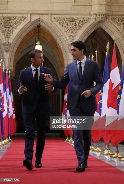 Canadian Prime Minister Justin Trudeau welcomes French President Emmanuel Macron at Parliament on June 7, 2018 in Ottawa. - French President Emmanuel...
