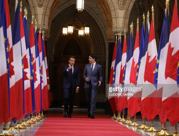 Canadian Prime Minister Justin Trudeau welcomes French President Emmanuel Macron at Parliament on June 7 2018 in Ottawa French President Emmanuel...