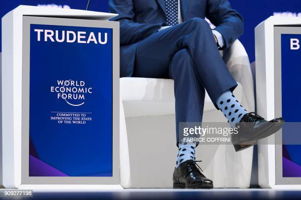 Canadian Prime Minister Justin Trudeau's polka dot socks are seen during the annual World Economic Forum on January 23 2018 in Davos eastern...
