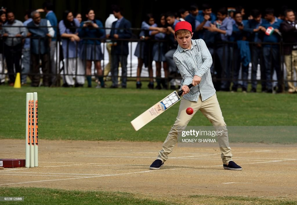Canadian Prime Minister Justin Trudeau's son Xavier plays a shot during a cricket event at a school in New Delhi on February 22, 2018. Trudeau and his family are on a week-long official trip to India. /