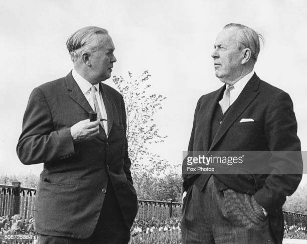 Canadian Prime Minister Lester B Pearson talking to his British counterpart Harold Wilson after his arrival in Ottawa June 3rd 1967
