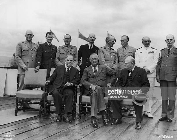 Canadian prime minister Mackenzie King American president Franklin Delano Roosevelt and British prime minister Winston Churchill sit while American...