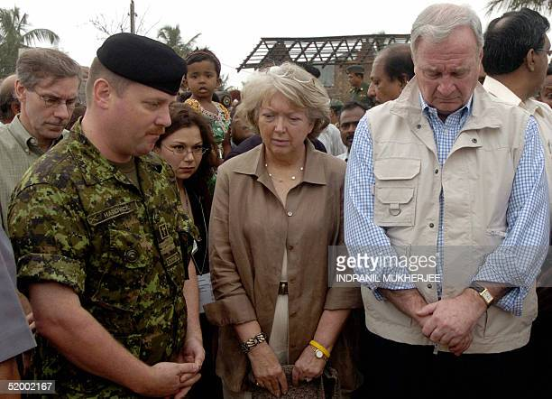 Canadian Prime Minister Paul Martin along with his wife Sheila observe a minute of silence to pay their respect to the 26 December tsunami tidal...