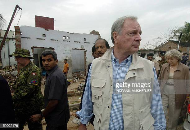 Canadian Prime Minister Paul Martin along with his wife Sheila inspects the destruction caused by the 26 December tsunami tidal waves during his tour...