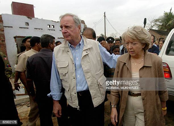Canadian Prime Minister Paul Martin along with his wife Sheila walk through the rubble at the tsunami devastated beach area in Kalmunai in the Ampara...