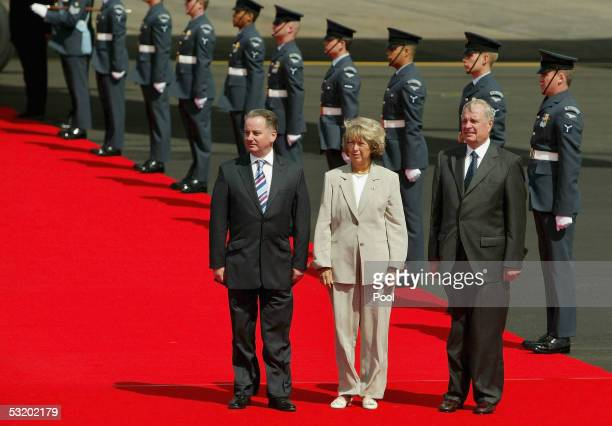 Canadian Prime Minister Paul Martin and his wife Sheila are met by Scotland's First Minister Jack McConnell at Prestwick Airport July 6 2005 in...