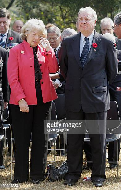 Canadian Prime Minister Paul Martin and his wife Sheila Martin attend a service of Remembrance at Sai Wan War Cemetery in Hong Kong 23 January 2005...