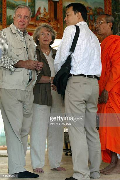 Canadian Prime Minister Paul Martin and his wife Sheila talk with a buddhist monk through an interpreter at a temple at Kamala beach on the...