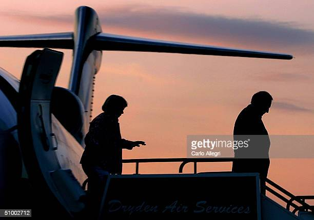 Canadian Prime Minister Paul Martin and wife Sheila Martin get off a plane for a campaign stop June 27 2004 in Winnipeg Canada Martin's Liberals and...