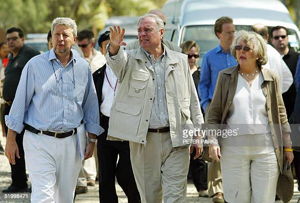 Canadian Prime Minister Paul Martin his wife Sheila and the Canadian Ambassador to Thailand Denis Comeau look where the tsunami struck at Kamala...