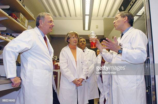 Canadian Prime Minister Paul Martin his wife Sheila Martin and others listen to Dr Ralph Durand a biophysicist as he displays tumor cells in a tissue...