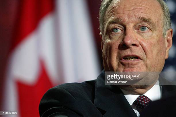 Canadian Prime Minister Paul Martin speaks to reporters during a joint press conference on November 30 2004 in Ottawa Canada During the press...