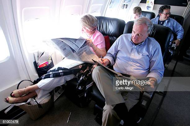 Canadian Prime Minister Paul Martin talks while his wife Sheila reads next to him on a plane June 27 2004 inbetween Gatineau and Toronto Canada...
