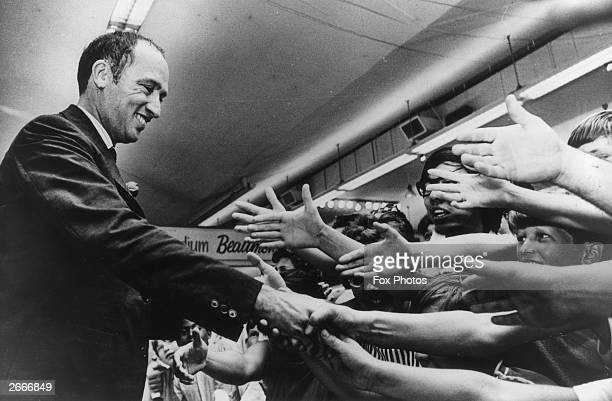 Canadian Prime Minister Pierre Elliot Trudeau shakes hands with admirers at the opening of the Canadian National Exhibition