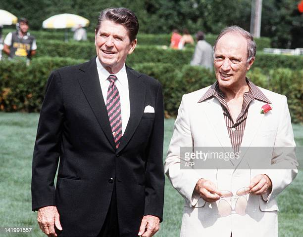 Canadian Prime Minister Pierre Elliott Trudeau and US President Ronald Reagan walks together 18 July 1981 in Ottawa during the Summit of the leading...