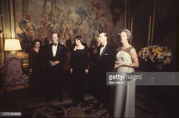 Canadian Prime Minister Pierre Trudeau and wife Margaret appear with Belgian Prime Minister Leo Tindemans and wife Rosa at reception prior to a...