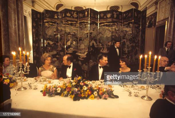 Canadian Prime Minister Pierre Trudeau chats with Rosa Tindemans and Belgian Prime Minister Leo Tindemans sits at right with Margaret Trudeau at a...